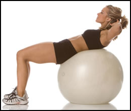 6 Best Ab Exercises- Exercise ball crunches add instability so that your abs work harder to keep you balanced.