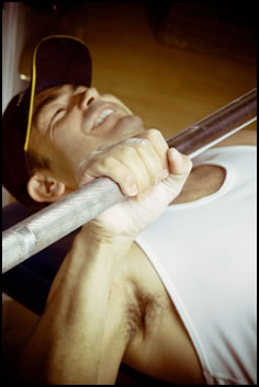 The bench press is an essential large, upper-body lift that appears in many basic strength training routines.