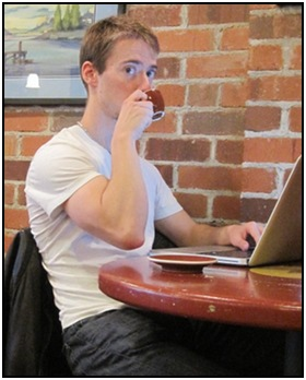 Me, writing strength training info after my daily workout - with my espresso!