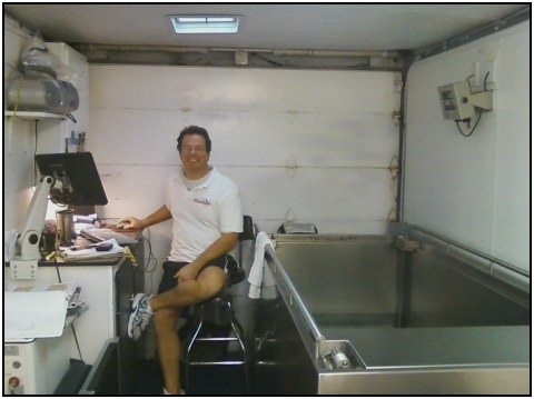 Brian smiling, while sitting next to the hydrostatic weighing tub.