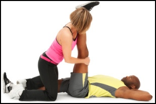 Increasing flexibility in the legs with the help of a partner in one use of PNF stretches.