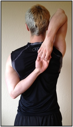 Shoulder stretches, hands grabbing behind the back.