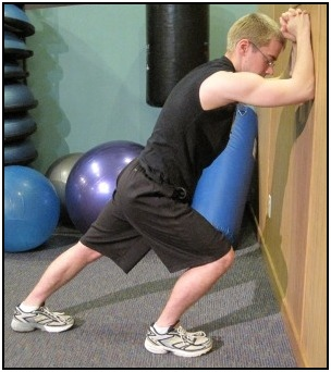 Standing calf stretch against the wall, position 2.
