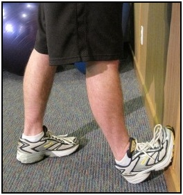 Standing calf stretch  with foot against the wall, position 2.