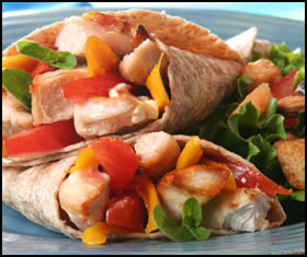 Healthy weight training foods, like this whole wheat tortilla with chicken and veges, will help your gain muscle faster.