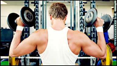 Weight training super sets with a shoulder press. The next movement might be shoulder circles or a barbell press.