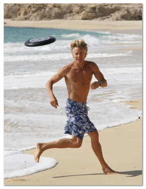 Mark Sisson playing on the beach, and looking good as a result of his primal diet.