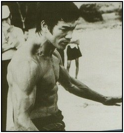 Bruce Lee Workouts, photo 2: Bruce's shoulder and forearm definition is really apparent in this shot.