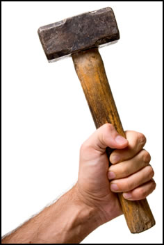 Improve grip strength by swinging a heavy sledgehammer.